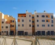 Edifici ricostruiti nel vecchio campo