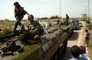 Soldati lealisti entrano a Rastan, ottobre 2011