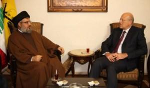 Il leader di Hezbollah Hasan Nasrallah e il premier libanese Najib Miqati