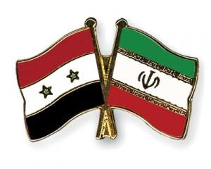 Le bandiere siriana e iraniana, simbolo di un'alleanza trentennale.