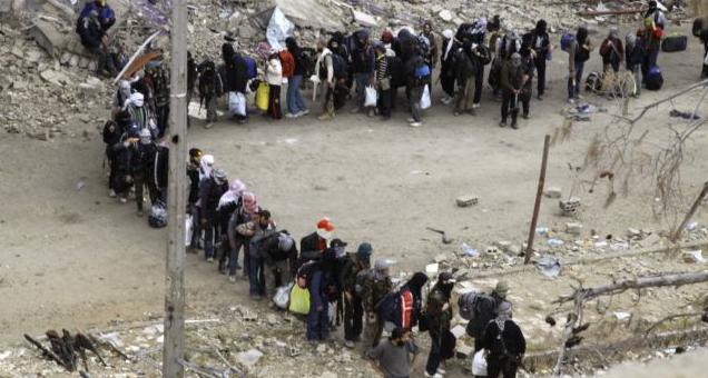 Gli ultimi miliziani anti-regime escono a Homs (Reuters)