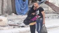 Una bambina in abito tradizionale, una coppia che si abbraccia sullo sfondo delle macerie, scene insolite per un campo profughi che da lunghi mesi è sotto assedio e dove si […]