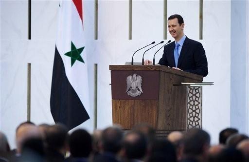 Bashar al Asad durante il discorso di insediamento, 17 luglio 2014 (AFP)
