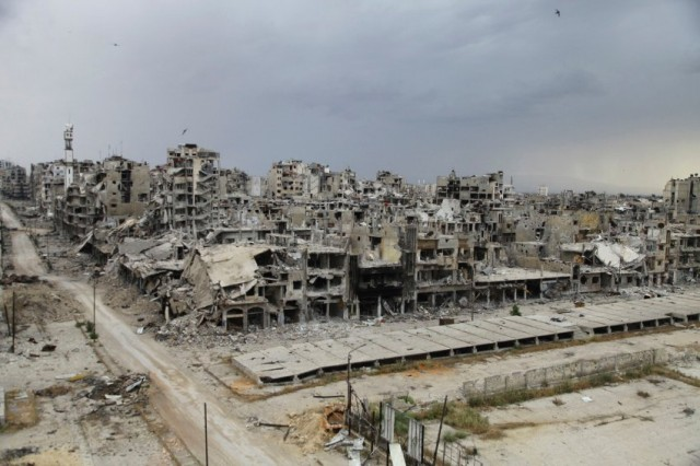 Destroyed buildings are pictured, after the cessation of fighting between rebels and forces loyal to Syria's President Assad, in Homs city