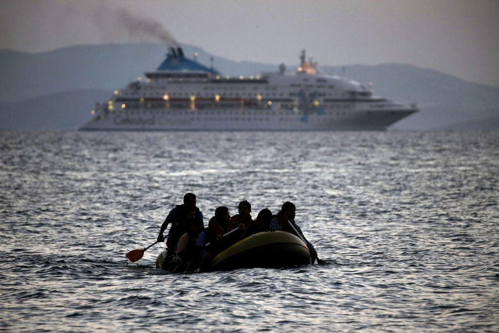 TOPSHOTS Migrants arrive on the shore of Kos island on a small dinghy on August 19, 2015. Authorities on the island of Kos have been so overwhelmed that the government sent a ferry to serve as a temporary centre to issue travel documents to Syrian refugees -- among some 7,000 migrants stranded on the island of about 30,000 people. The UN refugee agency said in the last week alone, 20,843 migrants -- virtually all of them fleeing war and persecution in Syria, Afghanistan and Iraq -- arrived in Greece, which has seen around 160,000 migrants land on its shores since January, according to the UN refugee agency.  AFP PHOTO / ANGELOS TZORTZINISANGELOS TZORTZINIS/AFP/Getty Images ORG XMIT: